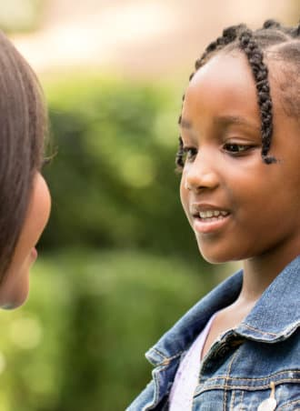 little girl smiling to the therapist