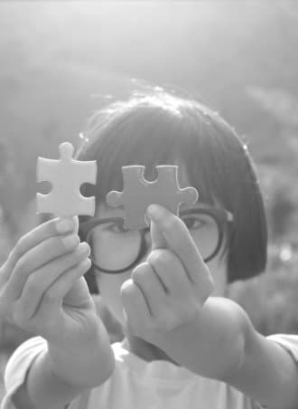 little girl holding a puzzle