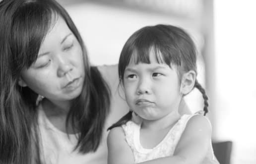 therapist observing the sad little girl
